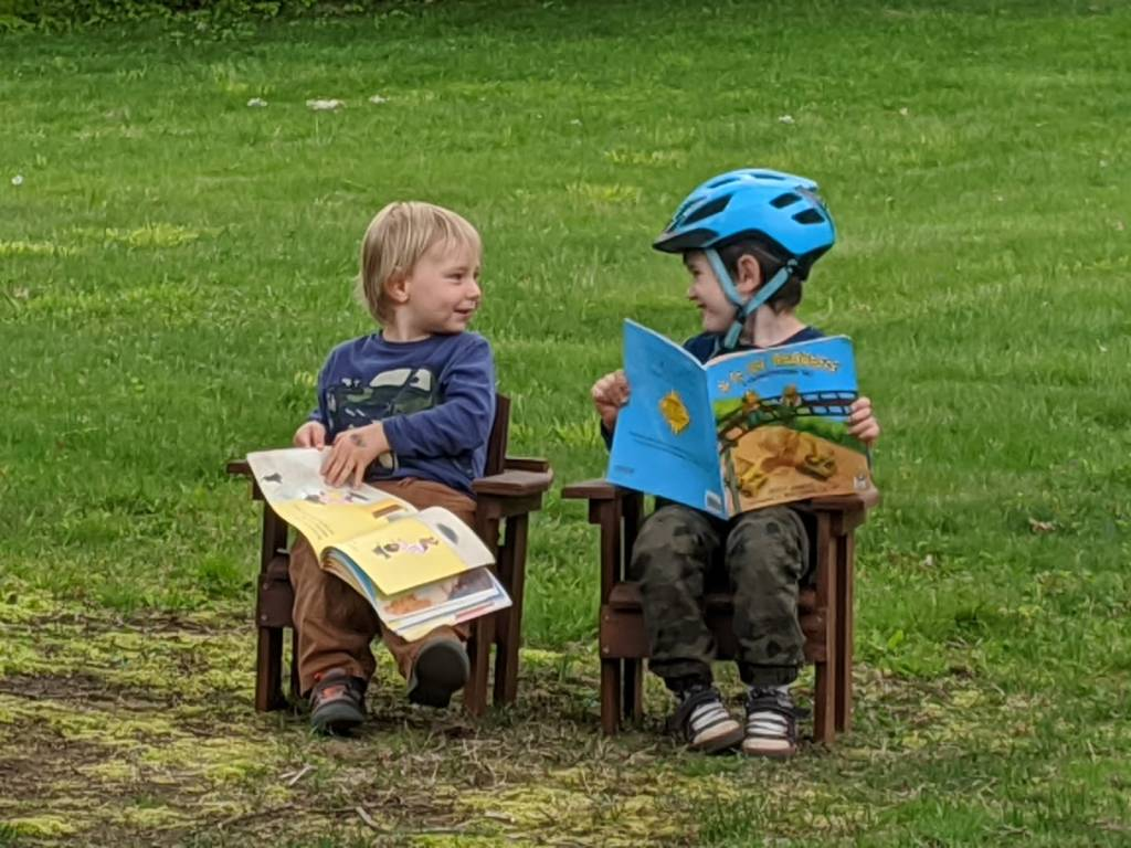 Boys reading books,